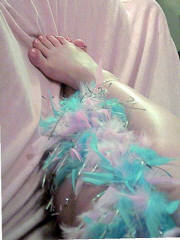 Foot pics of a cute pretty playful woman loves to use her bare feet soles and toes to give your bulging willie the best foot joy you've ever had...